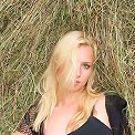 Blonde bombshell fingers herself in the hayloft of her barn.
