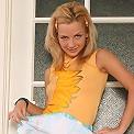 Ukrainian blonde strips in her kitchen