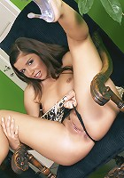 Cute young Peaches fingers dripping pussy on chair