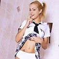 Sexy blonde looks cute with her pigtails