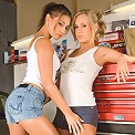 Hot girl on girl action in the garage