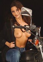 Sexy brunette rides her bike in the nude