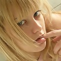 Cute blonde gets naughty in the bathroom