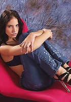 Hot brunette reveals all on the couch