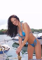 Stunning brunette naked by the seaside