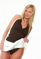 Blonde hottie looks stunning in the studio