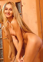 Blonde beauty Anna gets naughty in the bedroom