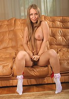 Cute Ukrainian teen gets naked on the couch