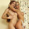 These 2 cute girls get together to suck cock