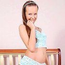 Helen posing in blue lace outfit