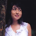 Beautiful sultry asian model tantilizes in her skimpy bikini