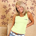 Tanned blond babe Connie drops mini skirt to play with her twat