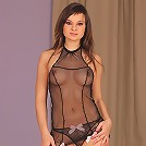 Teen babe Abbie shows off her sexy sheer body suit