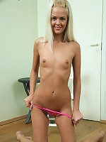 Blonde beauty Faith pulls up her skirt to show off her pink -panties