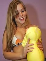 Nicole plays around in her sunset bikini
