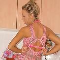 Maja strips in her kitchen
