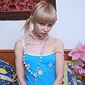 Spread teen in pearl necklace displays kooch