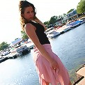 Jade posing in a long skirt outdoors