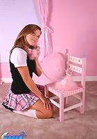 Karen spreads in a pink tartan skirt
