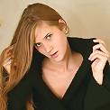 Allison in long black coat