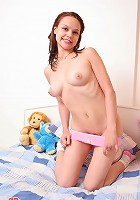 Naked girl with soft toys
