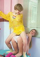 Teenage lesbians enjoying a dildo