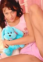 Adorable schoolgirl strokes clit