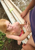 Teen couple shagging on a bridge