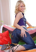 Cute blonde with dildo in her ass