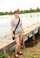 Teen near a lake pleasures cooch