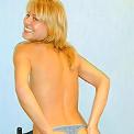 Blonde teenie showing her boobies