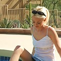 Dream Kelly has a little fun out by the pool on a sunny day.