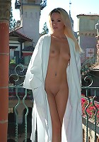 Kelly slides out of her white robe in public!