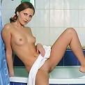 Glamorous teen beauty Mia with perfect tits takes bath