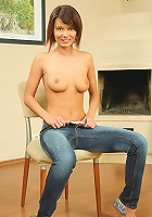Limber teen strips and spreads legs