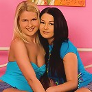 Charlotte and Antonia - Busty cuties lick and dildo in bed