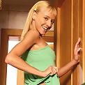 Slender blonde enticingly strips