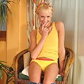 Adorable teen invitingly undresses