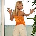 Heavenly blonde teasingly strips