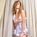 Who could resist this fresh-faced redhead, especially when she pulls her panties aside like that!