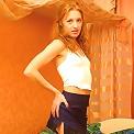 Redhead teeny plays with long dildo