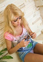 Blonde teen girl experiments with temporary tattoos