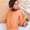 Tempting brunette teenie stripping