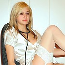 Young gorgeous nurse stripping