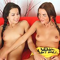 Young and lovely teens fingering each other on the red sofa