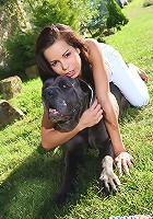 Sexy brunette teen plays with her cane corso