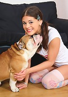 Cute teen Caprice playing with english bulldog